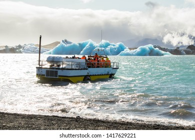 An amphibious сross-country vehicle, truck with the ability to move in the waters of the Jokulsarlon lake. Tours to perennial blue ice floes and glaciers floating in the lake in Iceland. Entertainment