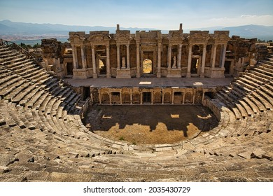 Amphitheater in ancient city of Hierapolis. Unesco Cultural Heritage Monument.The construction of the 1800-year-old Hierapolis Ancient Theatre It was started in the 1st century AD. Pamukkale, Turkey