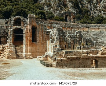 Amphitheater of the ancient city Mira Fragments of the necropolis of Lycian tombs carved into the rock