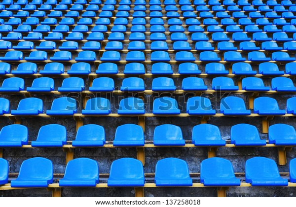 amphitheater of dark blue seats abstract background