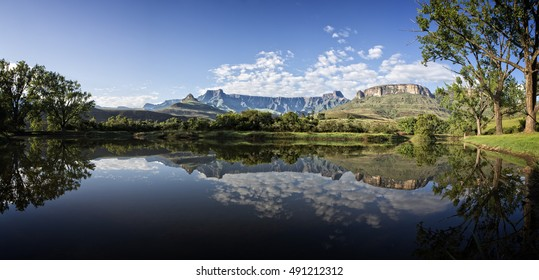 The Amphitheatre in the Drakensburg National Park in South Africa reflected in a lake.