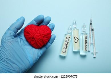 Ampoules with oxytocin, love hormone. Biochemistry in body.