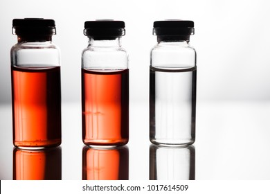 Ampoules with red liquid. On white background close up. Group of ampoules with a transparent medicine in medical laboratory