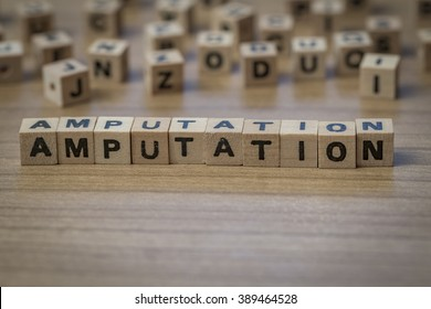 Amputation written in wooden cubes on a table