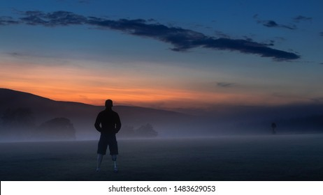 Amputee man looking at sunset in mountain