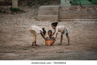 AMPYFY-MADAGASCAR-OCTOBER-17-2017:The child in Madagascar playing and 'Take a bath'with older sister,Malagasy's people village near Andranomandraotra geysers,located in Itasy Region, 12 Km.
