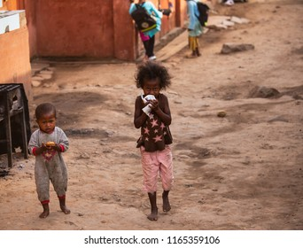 AMPYFY-MADAGASCAR-OCTOBER-17-2017:Two little boy and girl Malagasy holding a sweet are starving in the market at Ampyfy,Madagascar