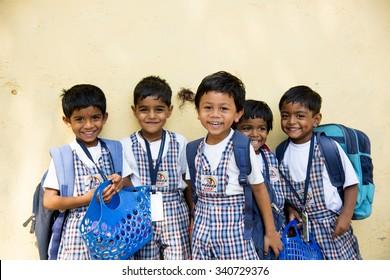 AMRAVATI, INDIA - October 10, 2015:  Happy small children dressed With bag in kindergarten, Amravati , Maharashtra, India