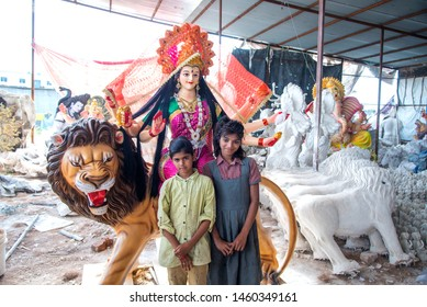 AMRAVATI, MAHARASHTRA, INDIA - 1 OCTOBER 2018: An unidentified artist making and giving finishing touches on sculptures of goddess Durga. The idols are made for the Hindu festival of Dasara & Navratri