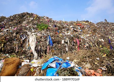 AMRAVATI, MAHARASHTRA, INDIA 12 OCTOBER 2020 : Mountain of garbage, large garbage pile, Pile of stink and toxic residue. These garbage come from urban areas, industrial areas.