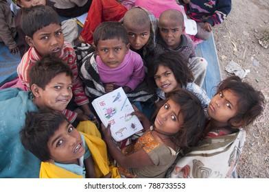 AMRAVATI, MAHARASHTRA, INDIA 15 NOVEMBER 2017 : Unidentified Indian children in a local school, children learn in street school.