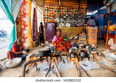 AMRAVATI, MAHARASHTRA, INDIA, 22 JANUARY 2018 : Unidentified woman making and cooking fresh food in village at vintage kitchen using firewood in earthen chulhas, daily lifestyle in rural area in India