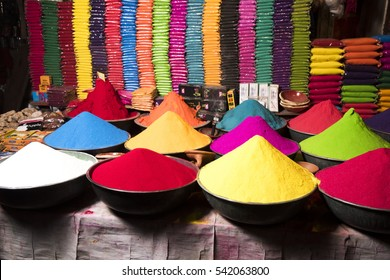 AMRAVATI, MAHARASHTRA, INDIA, 22 OCTOBER 2015 : unidentified store owner selling Colorful tika powders in a market at his shop during the Dussehra Festival Amravati. Maharashtra,india.