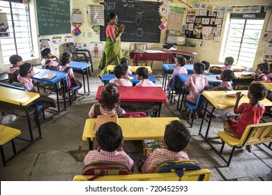 AMRAVATI, MAHARASHTRA, INDIA 22 SEPTEMBER 2017 : Unidentified teacher teaching to Indian rural school student in classroom,  Typical scene in a rural or small village school in India