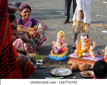 AMRAVATI, MAHARASHTRA, INDIA 23 SEPTEMBER 2018 : Unidentified faithful people perform pray of Hindu God Ganesha before immersion near water bodies (Ganesh Chaturthi  ).This is an annual festival.