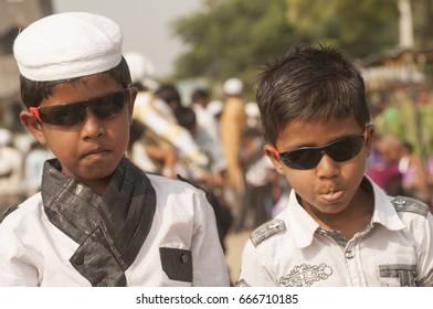 AMRAVATI, MAHARASHTRA, INDIA 26 JUNE 2017 : Portrait of happy unidentified Muslim children enjoying after offered morning prayer at the Eidgah on the occasion of Ramazan Eid.