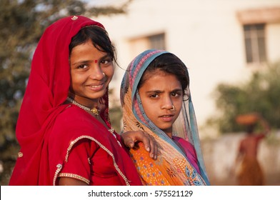 AMRAVATI, MAHARASHTRA, INDIA, 27 NOVEMBER 2016: Portrait of unidentified poor children playing at street in a slum area of city.