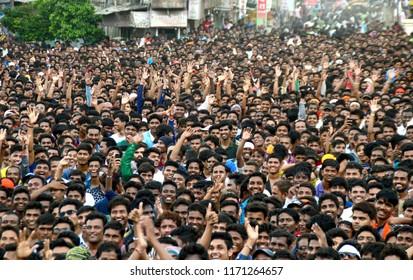 """AMRAVATI, MAHARASHTRA, INDIA - 28 AUGUST 2016  : Crowd of young People enjoying """"Govinda"""" at Dahi Handi festival to celebrate God Krishna's Birth."""