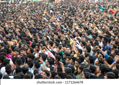 "AMRAVATI, MAHARASHTRA, INDIA - 28 AUGUST 2016  : Crowd of young People enjoying ""Govinda"" at Dahi Handi festival to celebrate God Krishna's Birth."