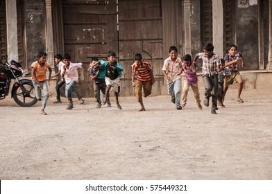 AMRAVATI, MAHARASHTRA, INDIA - 28 MARCH 2016 : Unidentified happy rural children playing at street of village Pusada.