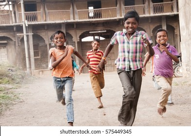 AMRAVATI, MAHARASHTRA, INDIA - 28 MARCH 2016 : Unidentified happy rural children playing at street of village Pusada.