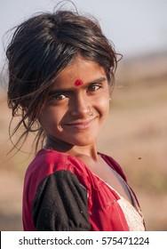 AMRAVATI, MAHARASHTRA, INDIA - 28 MARCH 2016 : Portrait of unidentified happy girl at street of village Pusada.