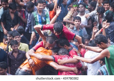AMRAVATI, MAHARASHTRA, INDIA - 29 AUGUST 2013 : Group of young men building of human tower, to catch and break the pot filled with butter, on day of celebration of hindu festival Janmashtami in india.