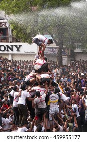 "AMRAVATI, MAHARASHTRA, INDIA - 29 AUGUST 2013 : Crowd of young People ""Govinda"" enjoying the Dahi Handi festival to celebrate God Krishna's Birth in Amravati, Maharashtra, India."