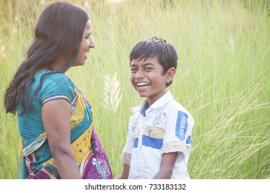 AMRAVATI, MAHARASHTRA, INDIA 31 OCTOBER 2016 : Unidentified happy Indian mother having fun with her son and Playing in the field at morning.