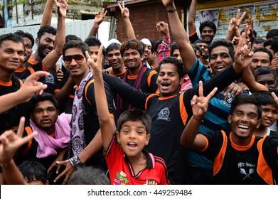 """AMRAVATI, MAHARASHTRA, INDIA - AUGUST 24 : Crowd of young People enjoying """"Govinda"""" at Dahi Handi festival to celebrate God Krishna's Birth in Amravati, Maharashtra, India. 24 August 2014"""