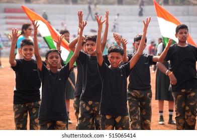 AMRAVATI, MAHARASHTRA, INDIA, JANUARY - 26, 2015: Unidentified Student celebrating the India Republic with flag Day stadium of city, January, 26, 2015 in Amravati, Maharashtra, India.