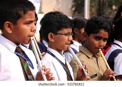 AMRAVATI, MAHARASHTRA, INDIA, JANUARY - 26, 2015 : unidentified school students  playing flute at stadium on occasion of India Republic Day, January, 26, 2015, Amravati, Maharashtra, India.