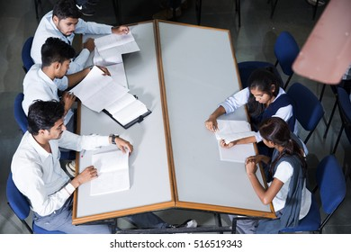 AMRAVATI, MAHARASHTRA,INDIA - 11 APRIL 2016 : Unidentified group of young students doing their studies together at their college library.