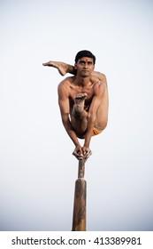 AMRAVATI,MAHARASHTRA, INDIA-OCT 22 :Unidentified student perform Malkhamb, a traditional Indian sport, perform on a wooden pole,on occasion festival Dussehra. Maharashtra,India,22 October 2015