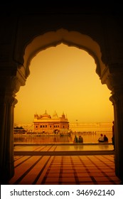 Amritsar Golden Temple, India. Framed with windows from west side in sunset. Focus on temple.