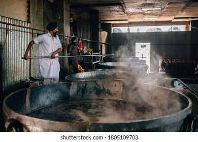 Amritsar, India - AUGUST 15: Cooks preparing food portion for pilgrims. The Kitchen at Golden Temple Feeds up to 100,000 People a Day for Free on AUGUST 15, 2016 in Harmandir Sahib, Amritsar, India.