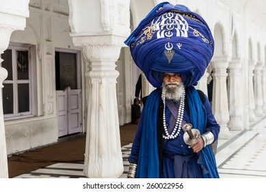 AMRITSAR, INDIA - JANUARY 26, 2015: Sikh man wearing an oversize turban at the Golden Temple on January 26, 2015 in Amritsar, Punjab, India.