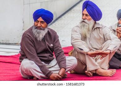 AMRITSAR, INDIA - JANUARY 26, 2017: Sikh devotees in the Golden Temple (Harmandir Sahib) in Amritsar, Punjab, India