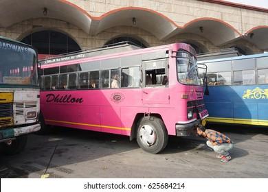 Amritsar India - March 22 2017 - Amritsar bus terminal. Pink bus goes to Atari, border town between India and Pakistan.