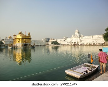 AMRITSAR, INDIA - NOVEMBER 20, 2013: Unidentified people by Golden Temple in Amritsar, India. It is the holiest Sikh gurdwara located in the city of Amritsar, Punjab, India