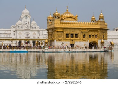 AMRITSAR, INDIA - SEPTEMBER 26, 2014: Unidentified Sikhs and indian people visiting the Golden Temple in Amritsar, Punjab, India. Sikh pilgrims travel from all over India to pray at this holy site.
