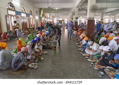 Amritsar Punjab India April 8th, 2014  Golden Temple Harmandir Sahib  Pilgrims  served unlimited food Langhar free kitchen charity