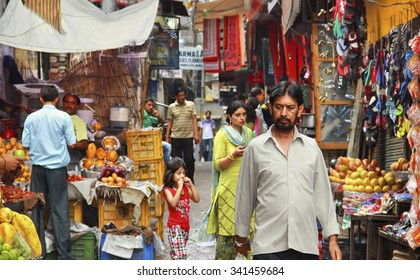 AMRITSAR/INDIA - JUNE 18. Indian city street full of people in market place on June 18, 2015 in Amritsar, Punjab, India.