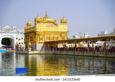 Amritser, Punjab / India - May 30 2019: The Harmandar Sahib also known as Darbar Sahib, is a Gurdwara located in the city of Amritsar, Punjab, India. It is the preeminent pilgrimage site of Sikhism.