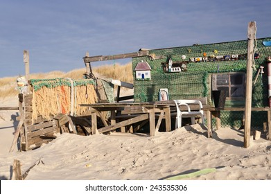 AMRUM, GERMANY - DECEMBER 29, 2014: On the Kniepsand Beach of  the North Frisian Island Amrum in Germany Land-Artists made Beach Huts and other Objects out of Flotsam and Jetsam