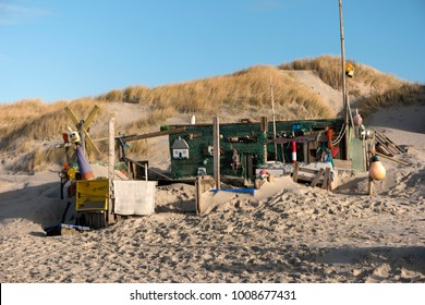 AMRUM, GERMANY - JANUARY 02, 2018: On the Kniepsand Beach of  the North Frisian Island Amrum in Germany Land-Artists made Beach Huts and other Objects out of Flotsam and Jetsam