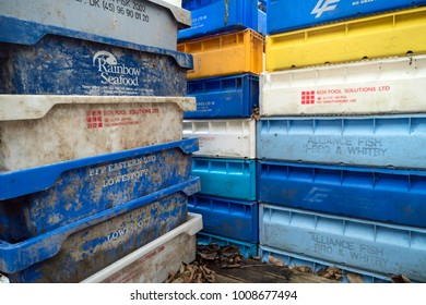 AMRUM, GERMANY - JANUARY 02, 2018: Fishing crates, buoys and other maritime objects in front of the old bar Blaue Maus on the North Frisian island Amrum in Germany