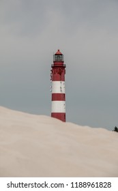 The Amrum lighthouse behind a dune
