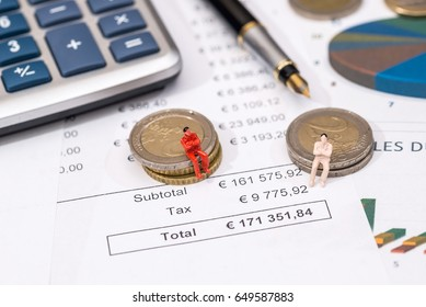 amsll toy people with euro coin and business graph.