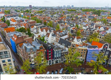Amsterdam aerial view. Beautiful view of Amsterdam with typical Dutch Houses. Amsterdam, Netherlands.